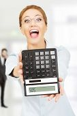 image of sos  - Fear woman with sos on calculator - JPG