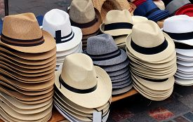 stock photo of stall  - Straw fedora hats stack sold on market stall - JPG