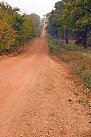 pic of dirt road  - a red dirt road in rural arkansas usa - JPG