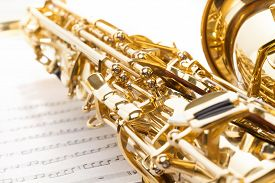 picture of musical scale  - Golden alto saxophone with detailed view of keys - JPG