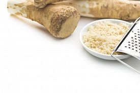 foto of grated radish  - grated horseradish root on white background - JPG