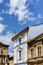 pic of tenement  - Renovated ancient tenement surrounded by dilapidated buildings in the Old Town Market Square in Bielsko - JPG