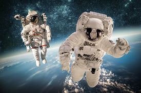 pic of spaceman  - Astronaut in outer space against the backdrop of the planet earth - JPG