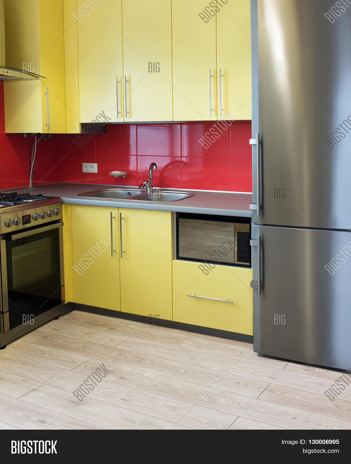 Yellow Kitchen Floor Yellow Kitchen With Cupboards With Hinged Doors Topped With A Grey