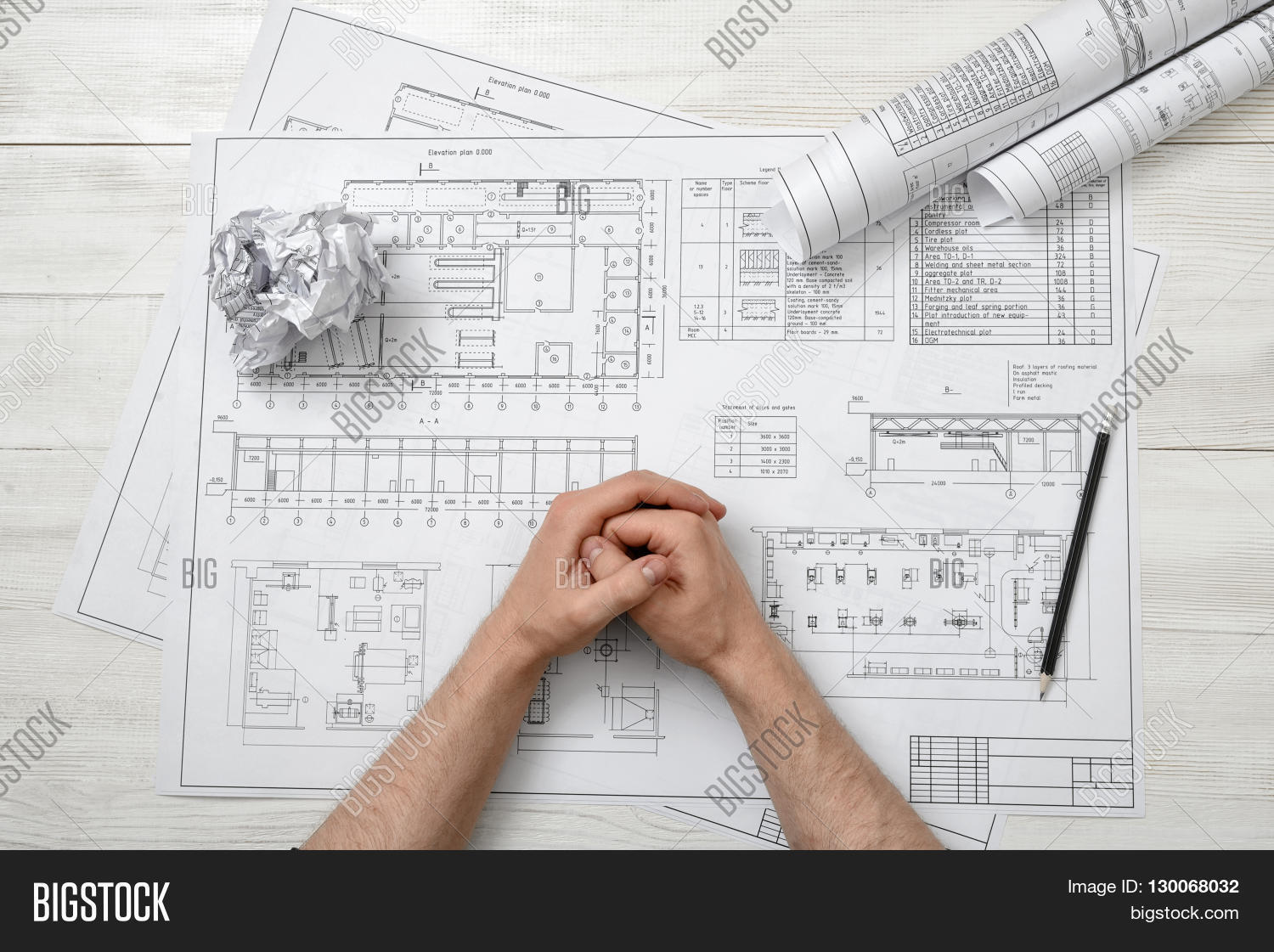 Top view folded hands man on wooden image photo bigstock for Architecture drawing 500 days of summer