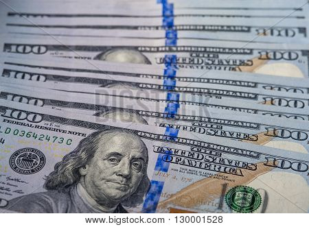 One hundred dollar bills background, horizontal view