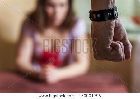 Man beating up his wife. Aggression in the family. Domestic violence. Selective focus.