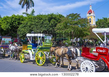 GRANADA NICARAGUA - MARCH 20 : Horse drawn wagons in Granada Nicaragua on March 20 2016. Granada was founded in 1524 and it's the first European city in mainland America