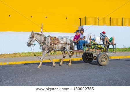 GRANADA NICARAGUA - MARCH 20 : Horse drawn wagon in Granada Nicaragua on March 20 2016. Granada was founded in 1524 and it's the first European city in mainland America