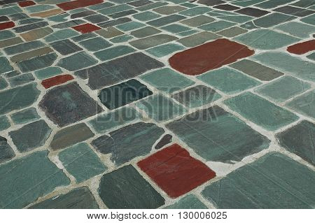 picture of an exterior granite tile walkway