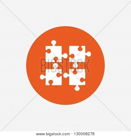 Puzzles pieces sign icon. Strategy symbol. Ingenuity test game. Orange circle button with icon. Vector