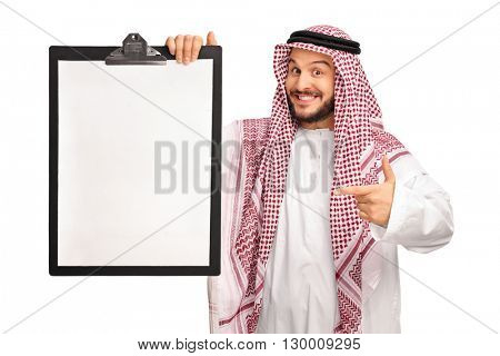 Young joyful Arab holding a clipboard and pointing towards it isolated on white background