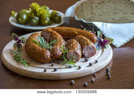 Aromatic sausage and tasty pickled cucumbers with herbs