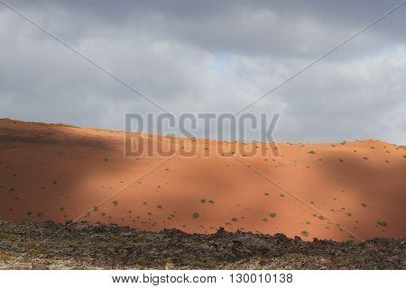 Desert arid peak stone volcanic mars landscape in Lanzarote, Canary Islands