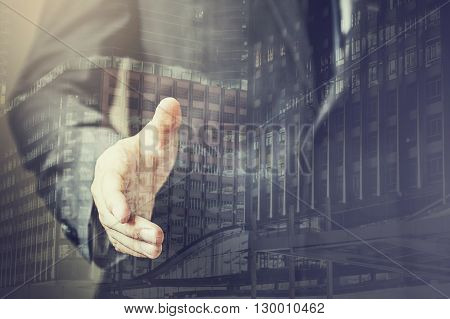 Double Exposure Of Businessman In Suit Ready To Handshake With Trust And Professionals