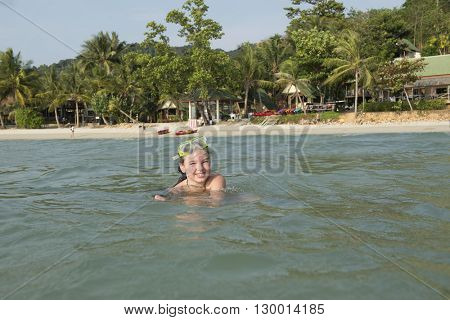 A tourist girl from Russia bathing in the sea at Koh Chang, Thailand