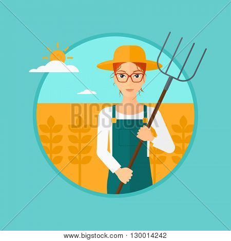 Farmer with pitchfork in wheat field.