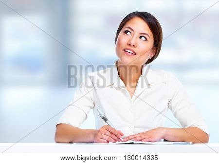Young business woman thinking.