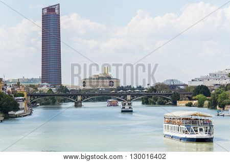 Guadalquivir river Seville Tower Triana bridge Seville Spain