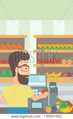 Cashier at supermarket checkout.