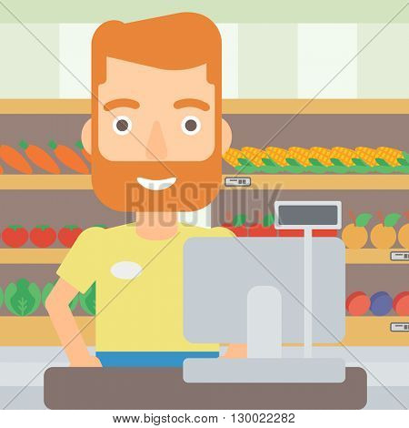 Salesman standing  at checkout.