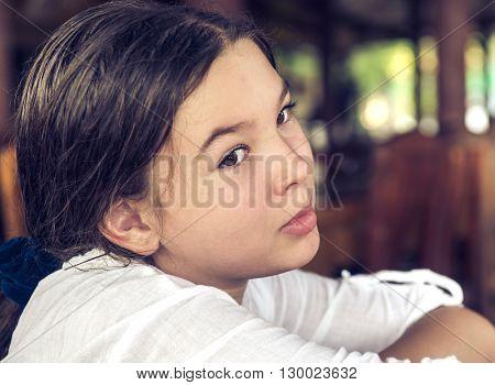 Portrait of brunette girl (10-11 years). LOMO effect