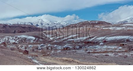 Altay gher campings under the snowy mountain and clouds