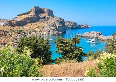 View of Acropolis and St Pauls harbour in Lindos. Rhodes Greece