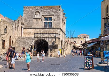 RHODES GREECE - JULY 4 2015: Tourists visiting and shopping at square of the Hippocrates in the historic old town of Rhodes