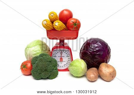 Fresh vegetables and kitchen scales on a white background close-up. horizontal photo.