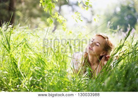 Young beautiful girl under the birch, close-up