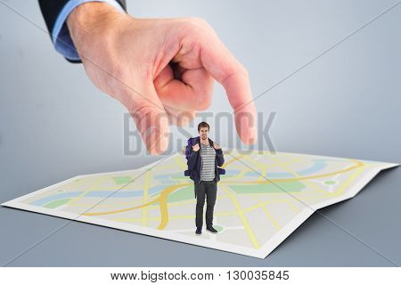 Portrait of happy man with backpack against city map