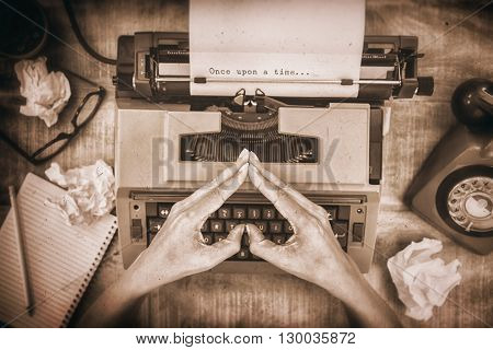 Once upon a time message on a white background against above view of typewriter and old phone