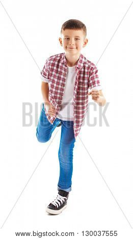 Little boy running forward, isolated on white