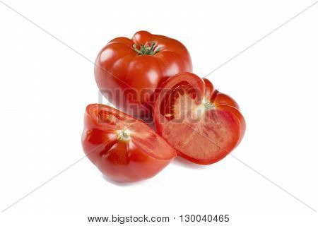 Fresh tomatoes whole and cut in half on white background