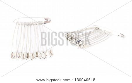 Bunch of metal safety pins isolated on white background, set of different foreshortenings