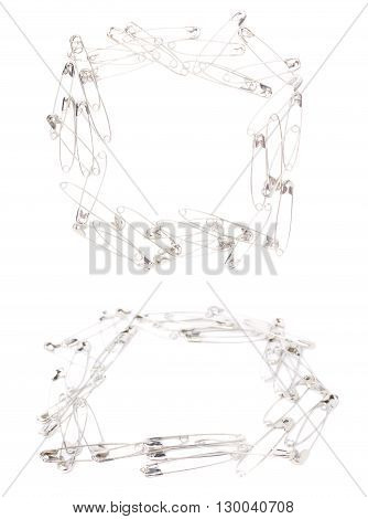 Square frame made of metal safety pins isolated on white background, set of different foreshortenings