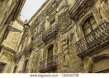 Lecce: Baroque balconies of an historic building