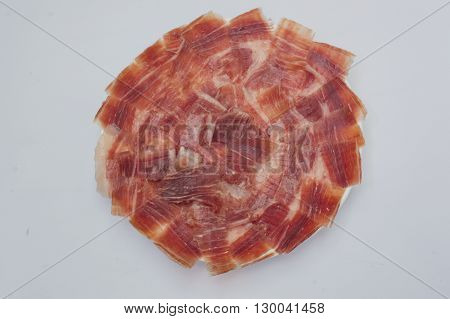 plate with sliced ham on white background ,