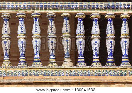 Ornate ceramic columns of balcony rail at Plaza de Espana, Seville