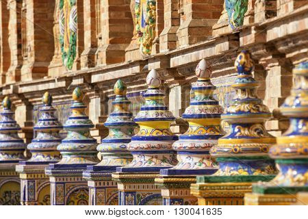 Detail of the ornate Province Alcoves along the walls of the Plaza de Espana, Seville