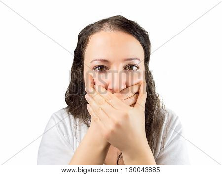 Shocked woman covering her mouth with hand against a white background