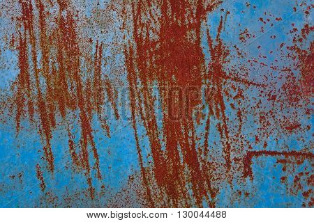 Red and blue metallic rusted surface as a textured vintage background