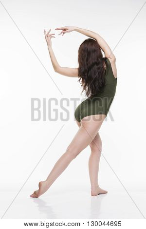 ?oung beautiful caucasian woman dancing in studio on white background. Sexy female body
