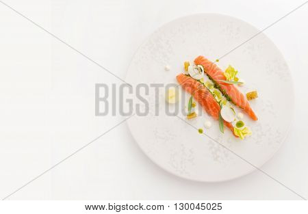 smoked salmon slices on white plate top view