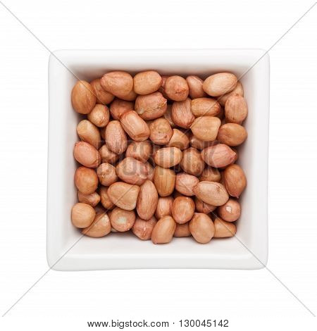 Shelled peanuts in a square bowl isolated on white background