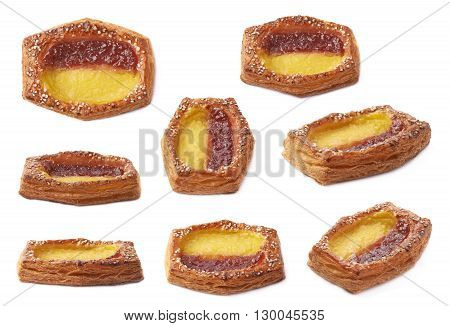 Sweet bread bun pastry filled and covered with the red and yellow cream filling, isolated over the white background, set of eight different foreshortenings