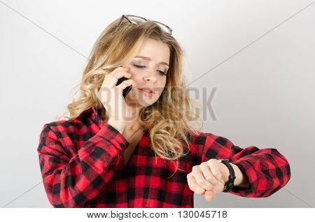 Woman With Phone Looking At Wrist Watch, Late