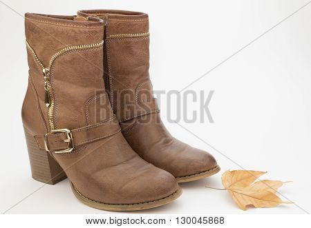 Pair of female brown cowboy style boots
