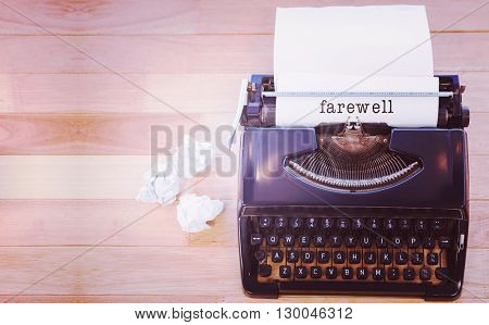 Farewell message on a white background against typewriter with paper on table in office